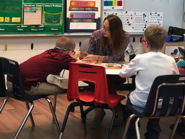 Ms. Smythe working with her students.